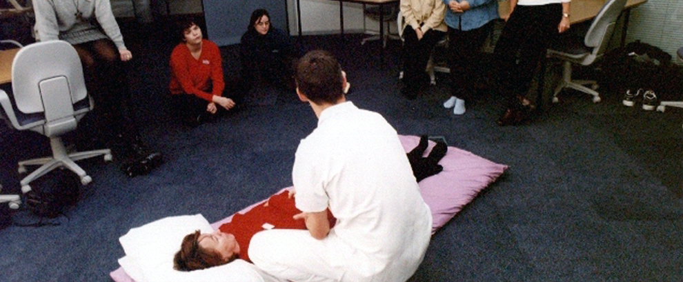 Des, teaching at a Shiatsu workshop